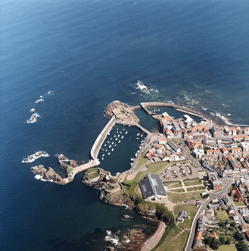 Oblique aerial view centred on the harbour with the remains of the battery adjacent, taken from the WSW.
