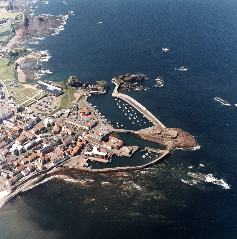 Oblique aerial view centred on the harbour with the remains of the battery adjacent, taken from the SW.