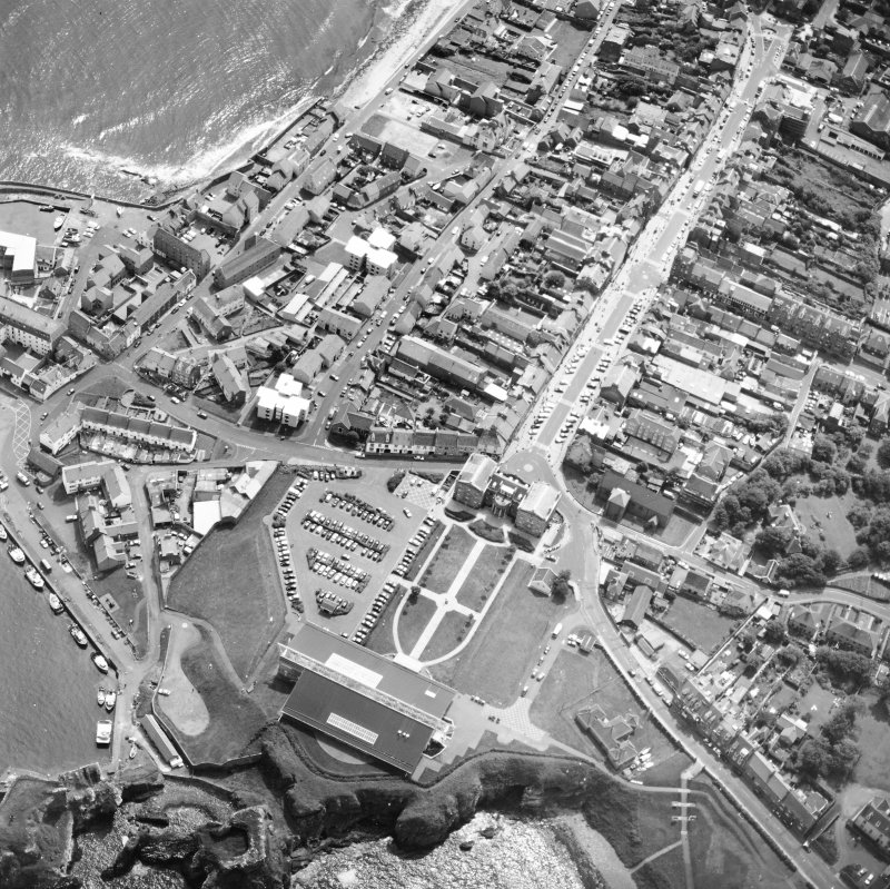 Oblique aerial view centred on the barracks with fishermen's housing at Victoria Place and leisure centre adjacent, taken from the NW.