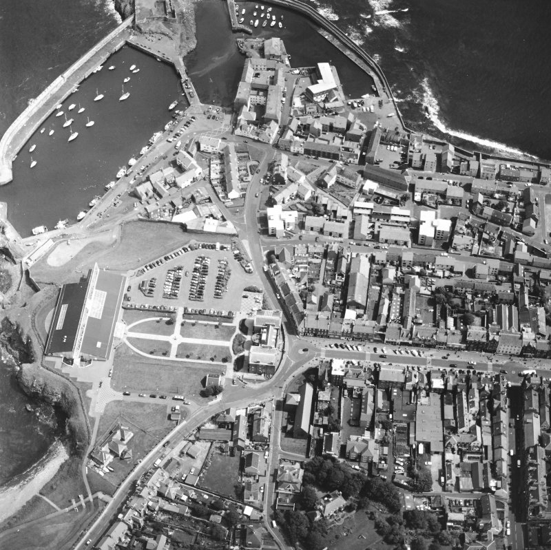 Oblique aerial view centred on the barracks with fishermen's housing at Victoria Place, harbours and leisure centre adjacent, taken from the WSW.