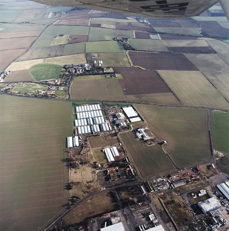 Oblique aerial view centred on the farm, buildings, farmhouse and mushroom farm with farmhouse and buildings adjacent, taken from the W.