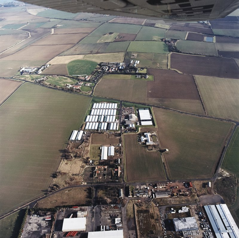 Oblique aerial view centred on the farm, buildings, farmhouse and mushroom farm with farmhouse and buildings adjacent, taken from the WSW.