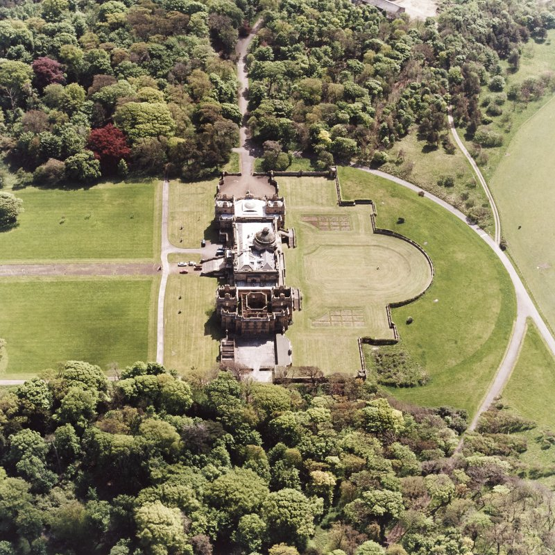 Oblique aerial view of house and formal gardens from SSE.