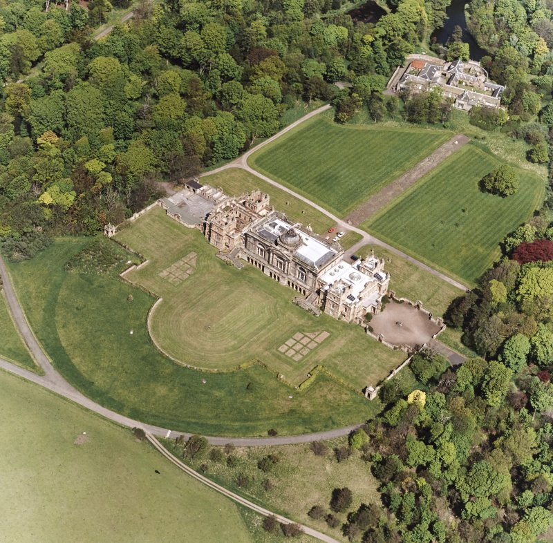 Oblique aerial view showing house, formal gardens, coach house and stables from SW.