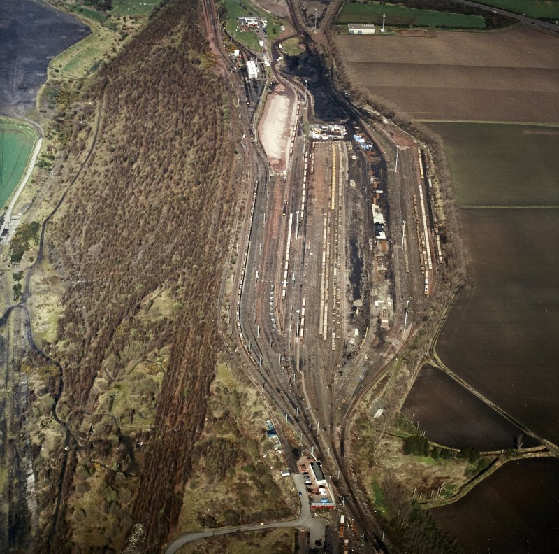 Oblique aerial view centred on the railway marshalling yard, taken from the SSE.