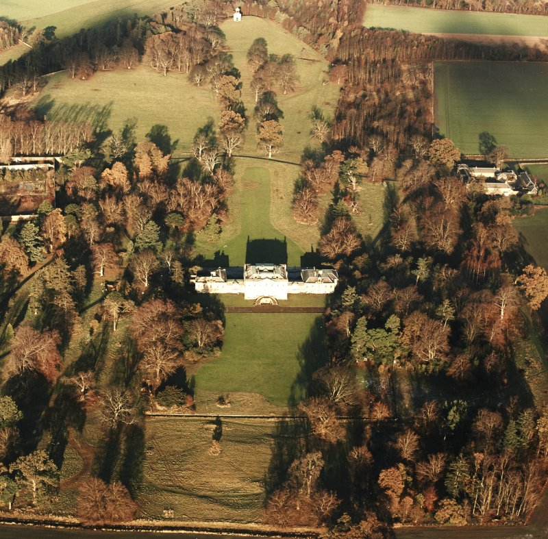 Preston Hall, oblique aerial view, taken from the S, centred on the country house with the stables and formal gardens on either side.