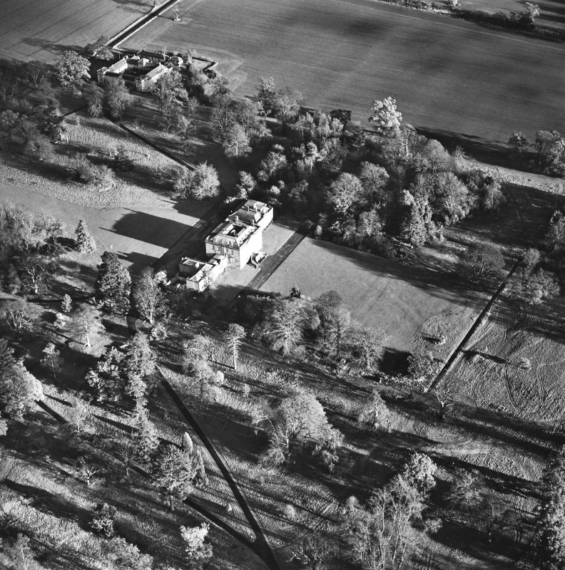 Preston Hall, oblique aerial view, taken from the SW, centred on the country house with the stables in the top left-hand corner of the photograph.