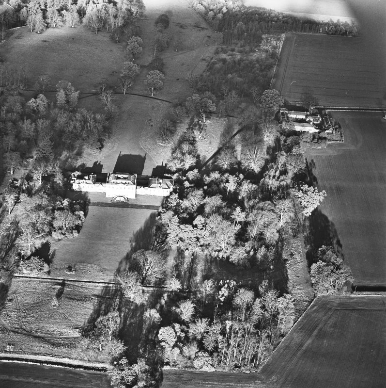 Preston Hall, oblique aerial view, taken from the SSE, centred on the country house with the stables in the top right-hand corner of the photograph.