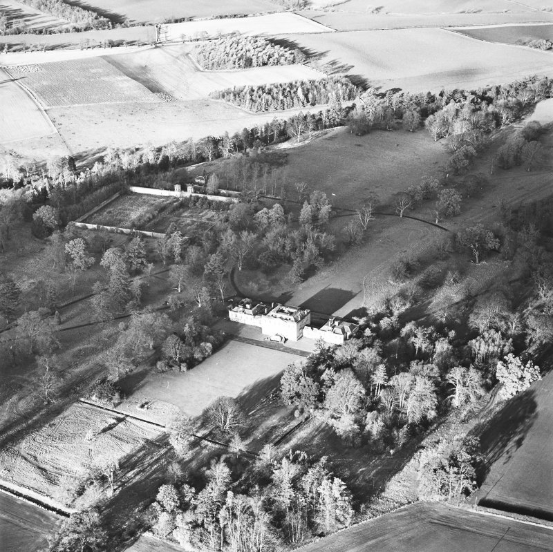 Preston Hall, oblique aerial view, taken from the SE, centred on the country house with the formal garden in the centre left of the photograph.