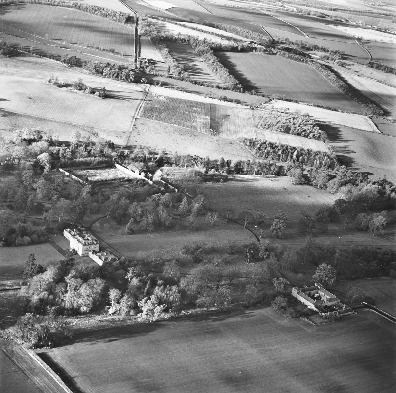Preston Hall, oblique aerial view, taken from the ESE, centred on the country house with the stables and formal gardens on either side.