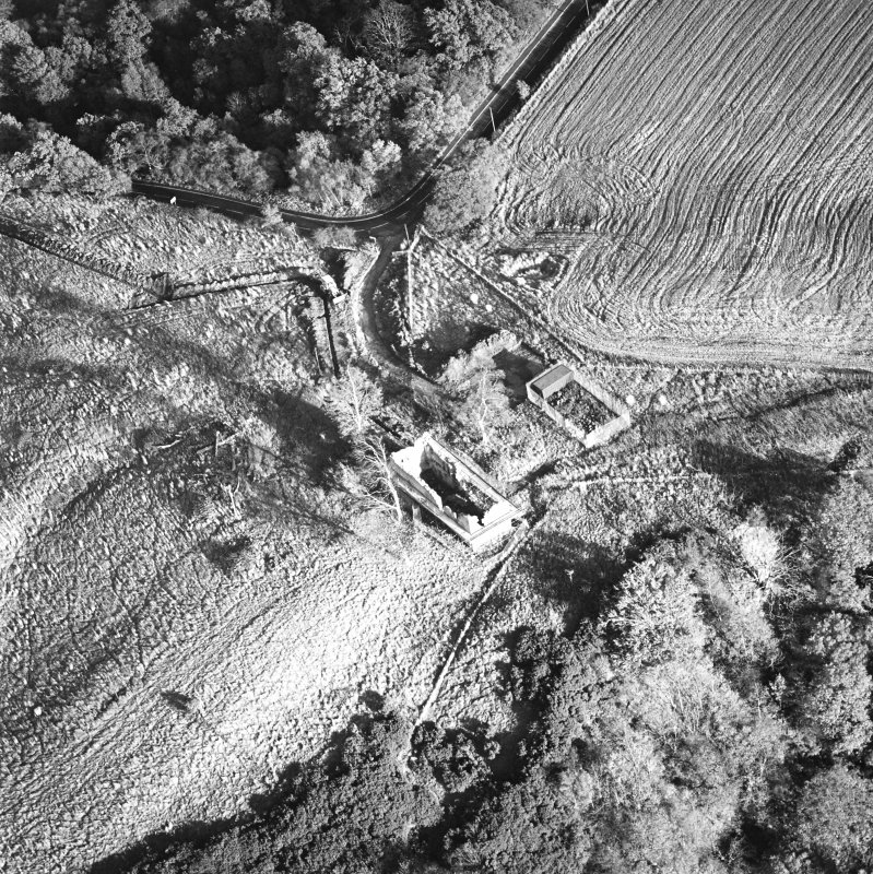Oblique aerial view of Penicuik, Castle Brae, Uttershill Castle centred on the remains of a tower-house, taken from the W.