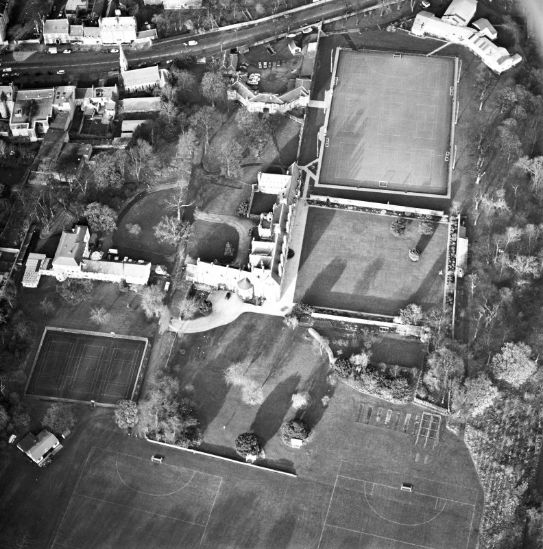 Oblique aerial view centred on the tower-house, school and garden, taken from the SSE.