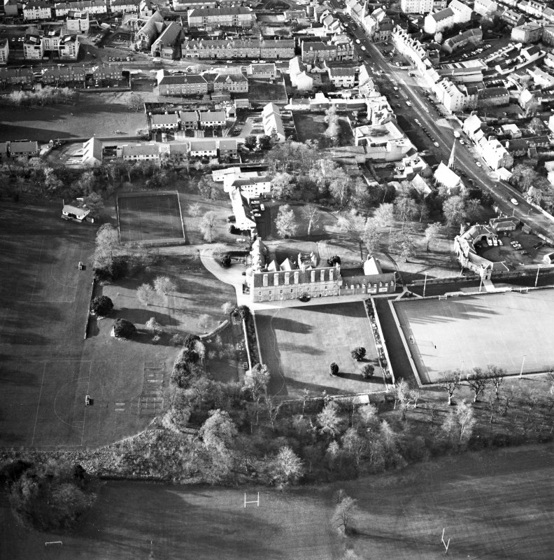 Oblique aerial view centred on the tower-house, school and garden, taken from the E.