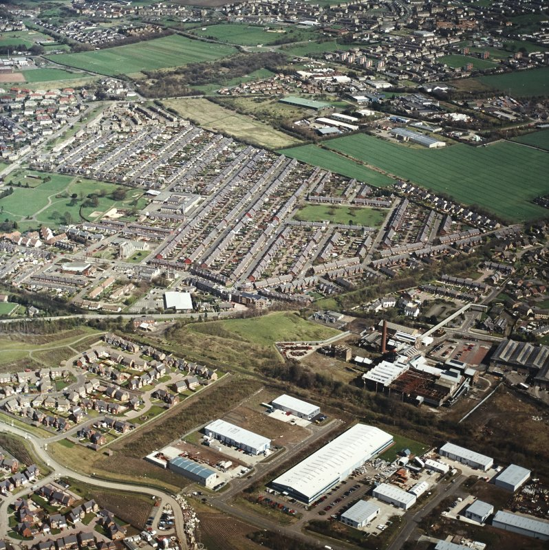 Oblique aerial view centred on the village, miners' rows and colliery, taken from the SW.