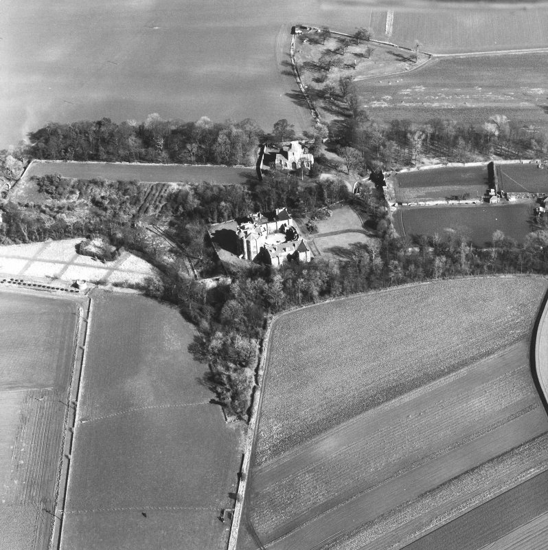 Oblique aerial view of house, garden, Collegiate Church from SW.