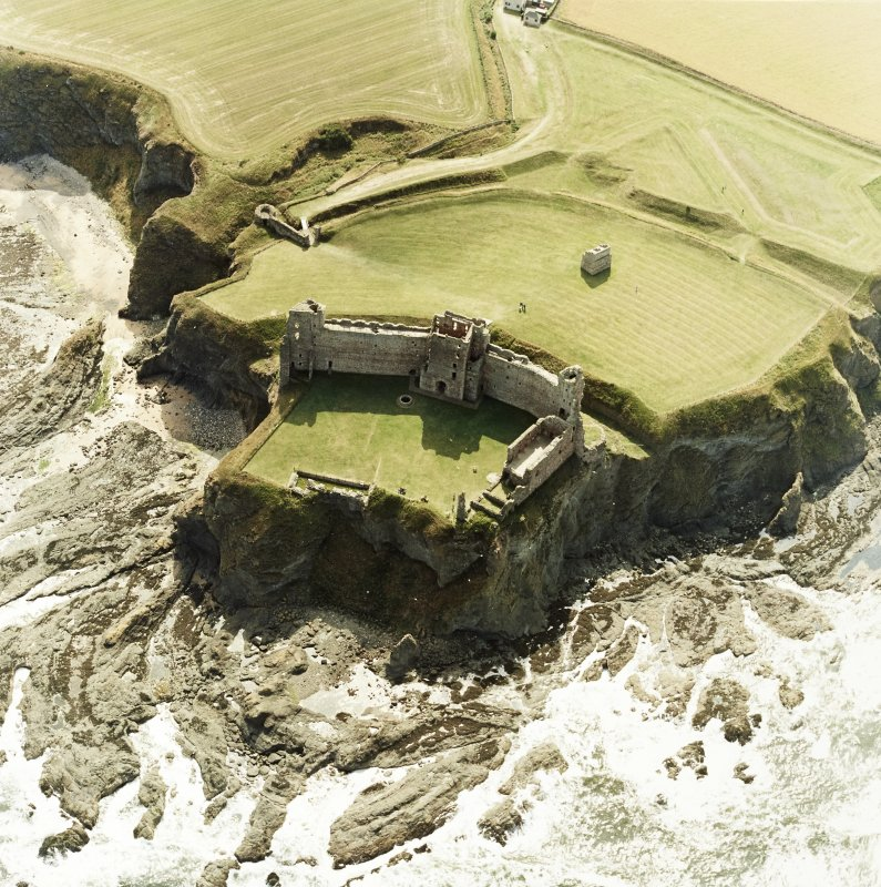 Oblique aerial view centred on the remains of the castle, taken from the NE.