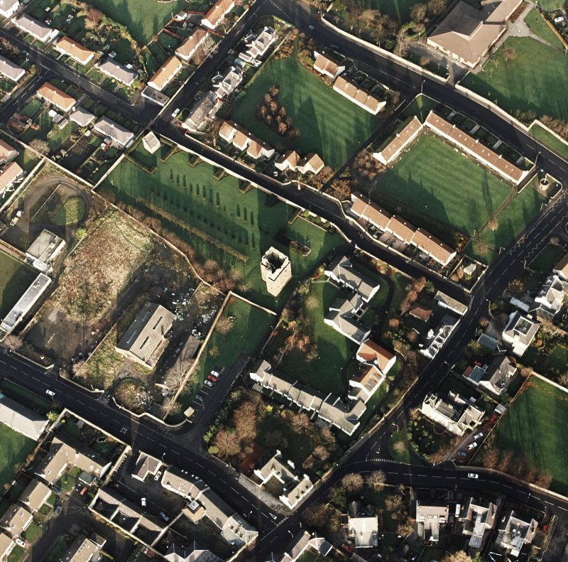 Oblique aerial view of the Preston Tower centred on the tower-house with a dovecot adjacent, taken from the SW.