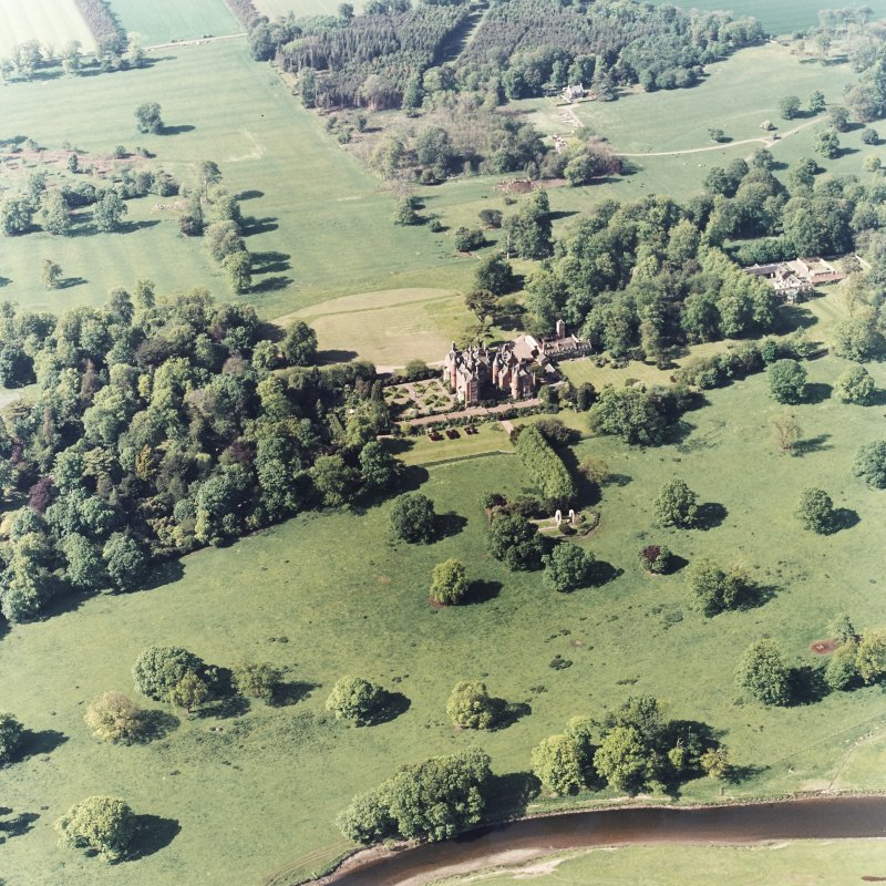 Aerial view of Tyninghame House, the site of Tyninghame manse, St Baldred's Church, the sundial and gardens and the clock tower court, taken from the S.