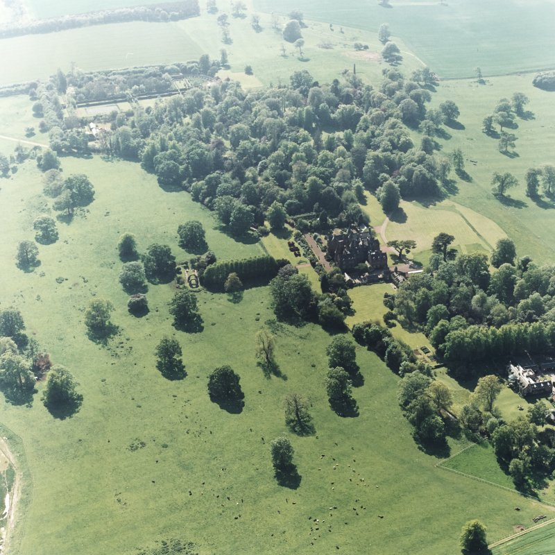 Aerial view of Tyninghame House, the site of Tyninghame manse, St Baldred's church, the clock tower court and the obelisk, taken from ENE.
