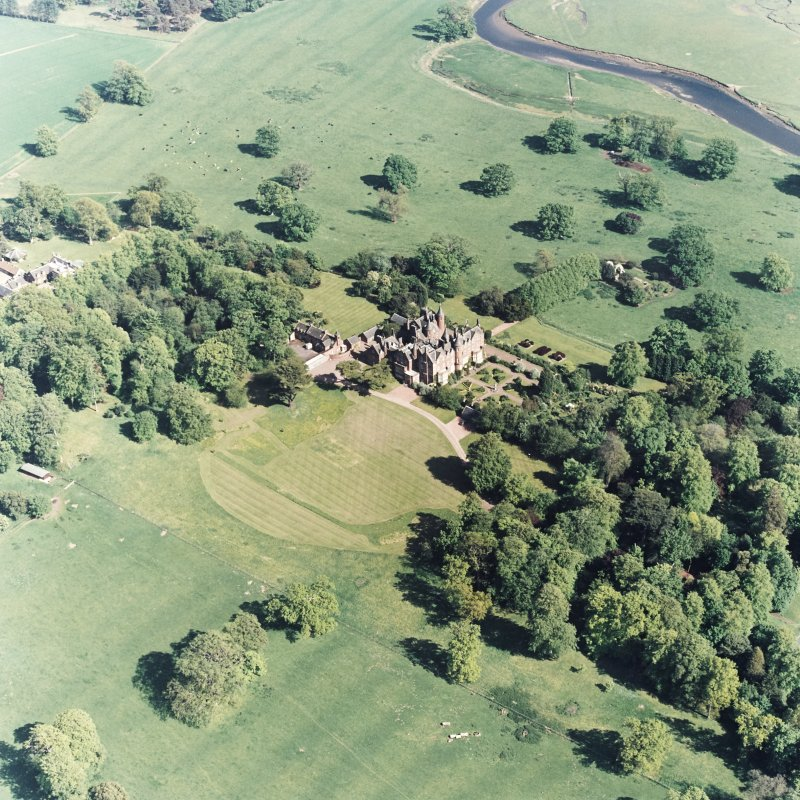 Aerial view of Tyninghame House, the site of Tyninghame manse, St Baldred's church, the sundial and gardens, and the clock tower court, taken from the N.