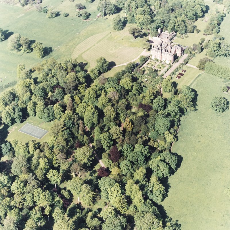 Aerial view of Tyninghame House, the site of Tyninghame manse, the sundial and gardens, and the clock tower court, taken from the SW.