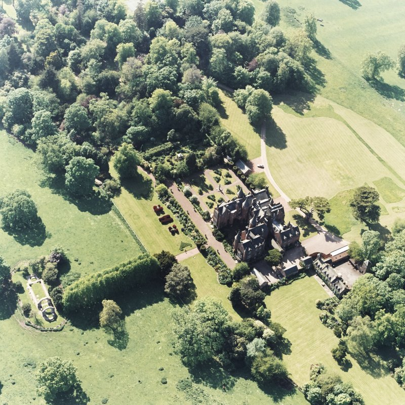 Aerial view of Tyninghame House, the site of Tyninghame manse, St Baldred's church, the sundial and gardens and the clock tower court, taken from the SE.