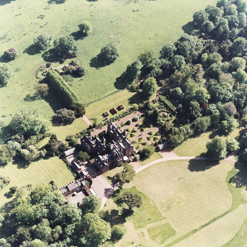 Aerial view of Tyninghame House, the site of Tyninghame manse, St Baldred's church, the sundial and gardens and the clock tower court, taken from the NE.