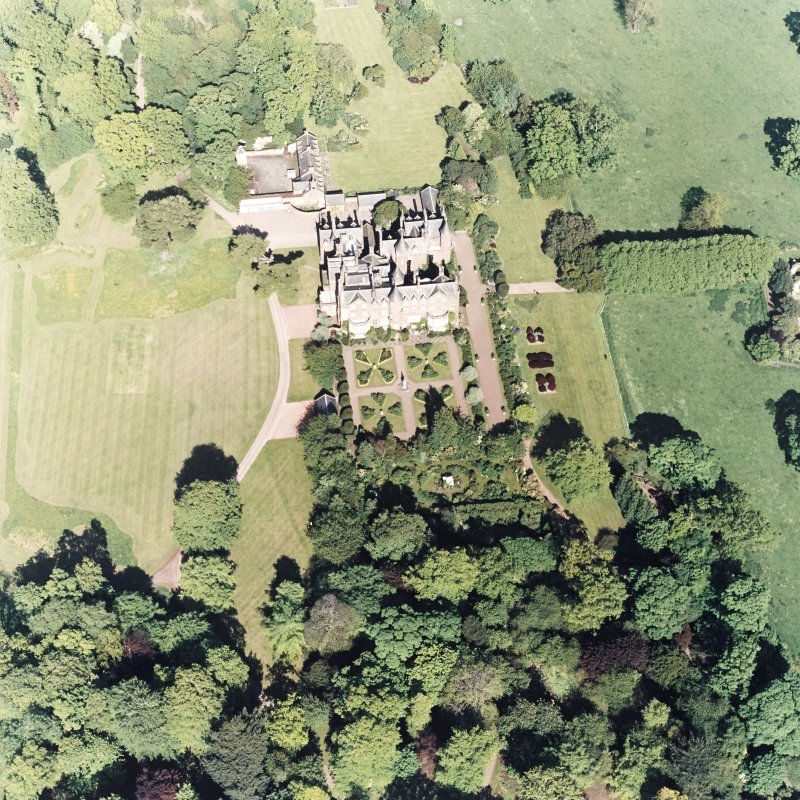 Aerial view of Tyninghame House, the site of Tyninghame manse, the sundial and gardens and the clock tower court, taken from the N.