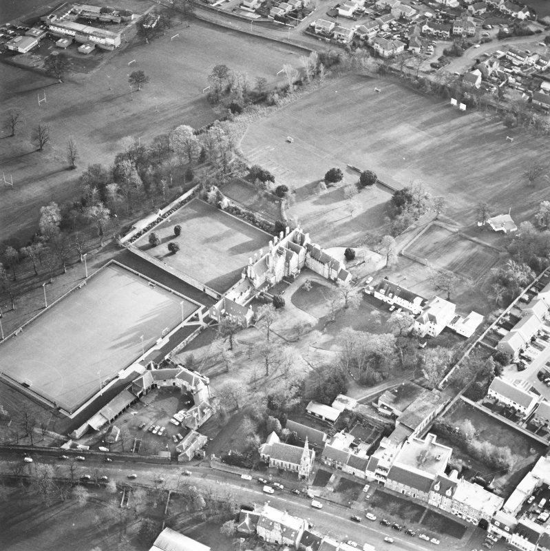 Oblique aerial view centred on the tower-house, school and garden, taken from the NW.
