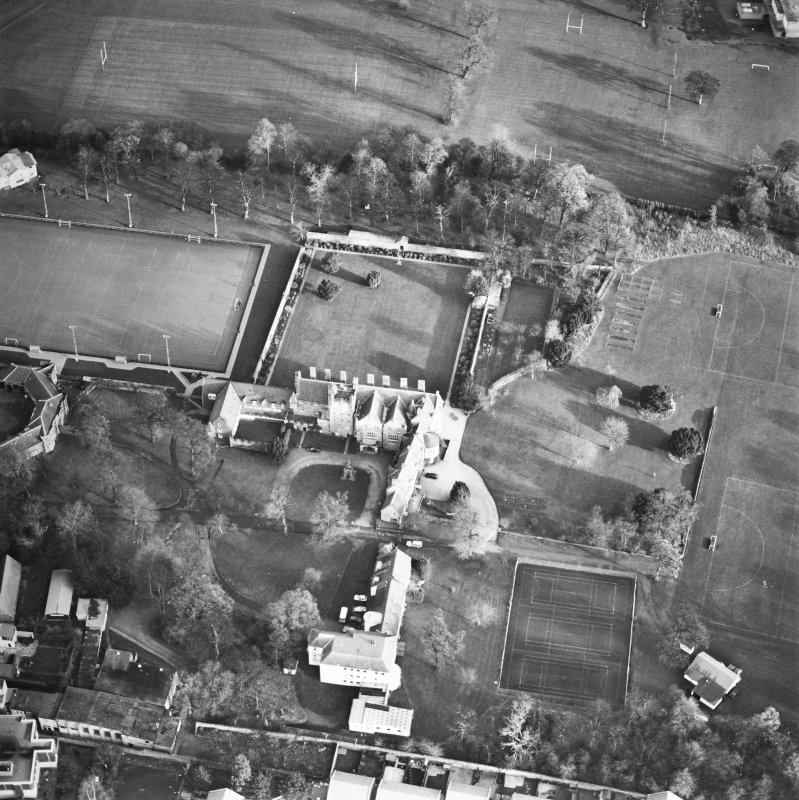 Oblique aerial view centred on the tower-house, school and garden, taken from the WSW.