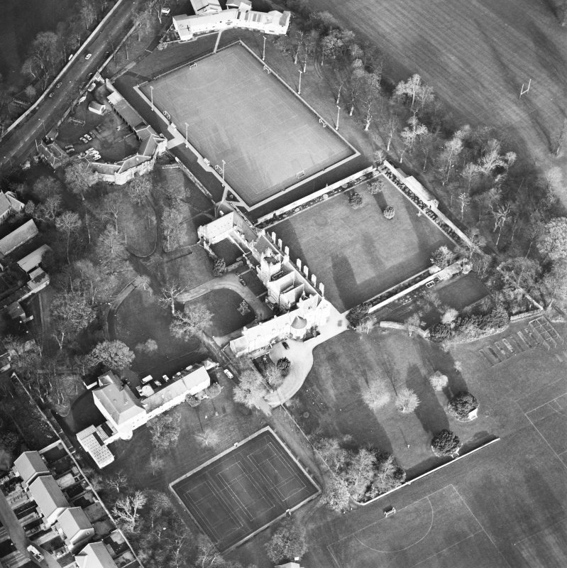 Oblique aerial view centred on the tower-house, school and garden, taken from the SW.