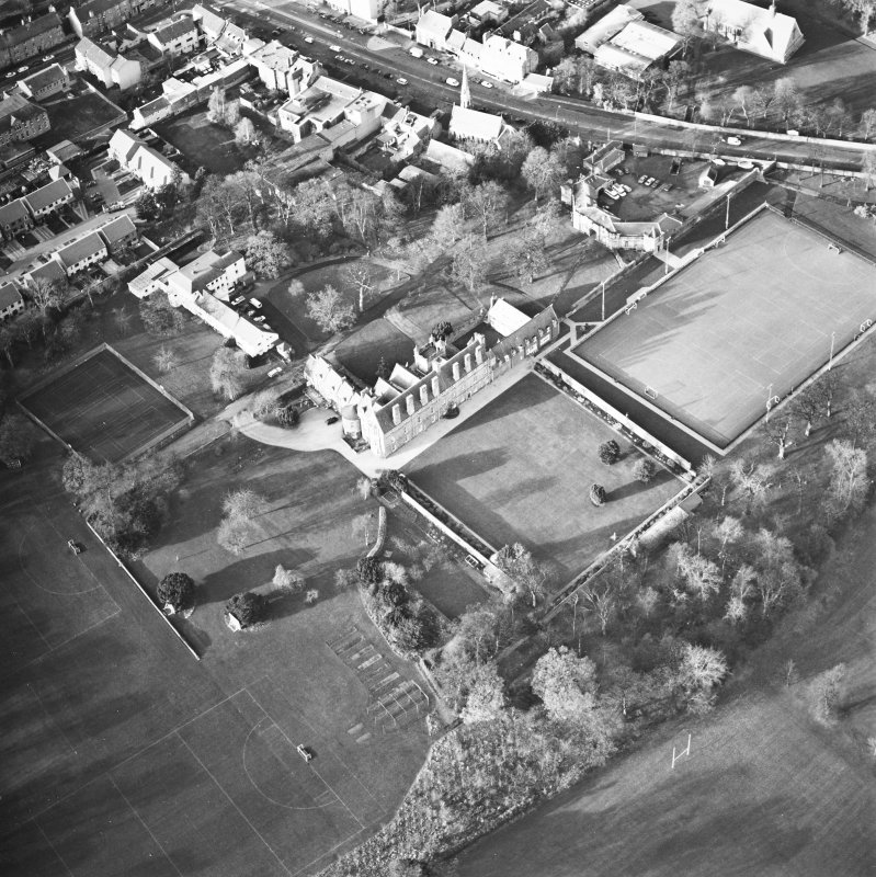 Oblique aerial view centred on the tower-house, school and garden, taken from the SE.