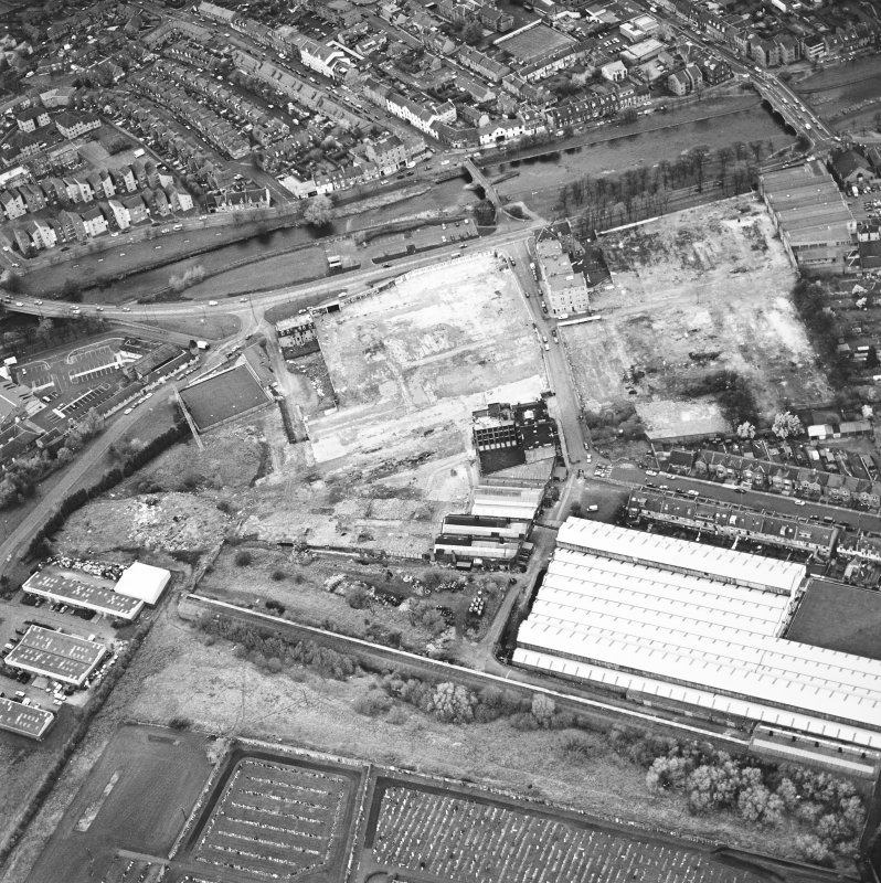 Aerial view of Brunton Ltd wire works, excavation and River Esk bridges, taken from the SE.