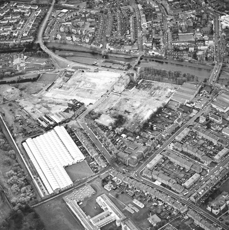 Aerial view of Brunton Ltd wire works, excavation and River Esk bridges, taken from the ESE.