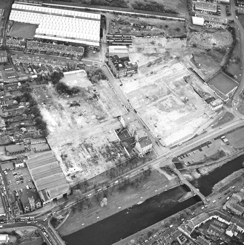 Aerial view of Brunton Ltd wire works, excavation and River Esk bridges, taken from the NE.
