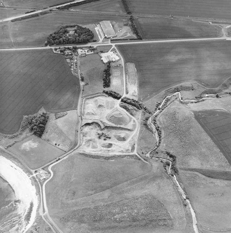 Oblique aerial view centred on the quarry with the farmhouse adjacent, taken from the NNE.