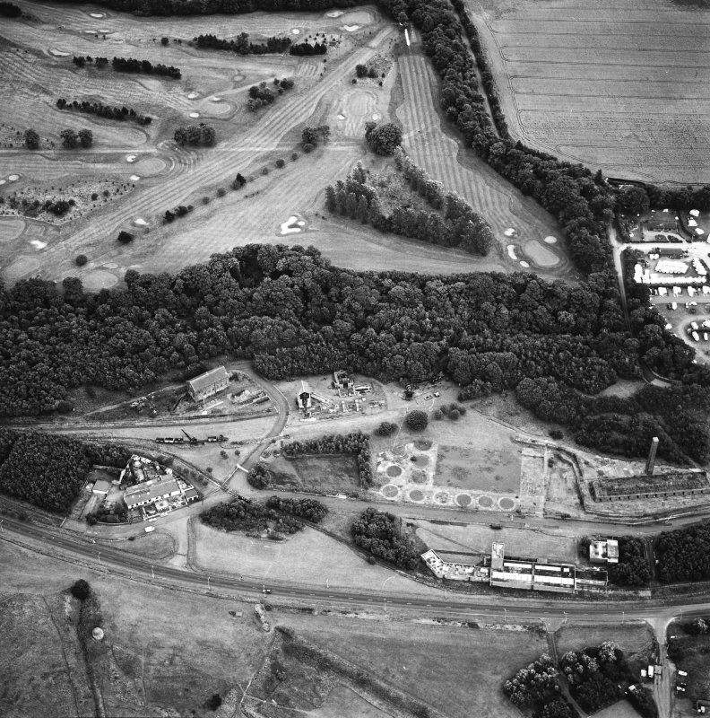 Oblique aerial view centred on the museum and remains of the coal mine, brick-works, tile-works and harbour, taken from the NNW.