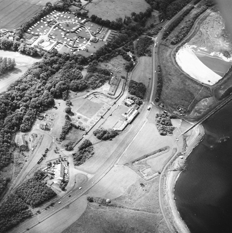 Oblique aerial view centred on the museum and the remains of the coal mine, brick and tileworks and harbour, taken from the NNE.