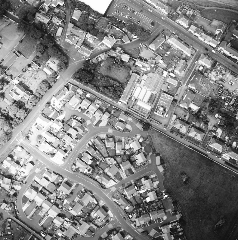 Oblique aerial view centred on the house and stables, taken from the ESE.