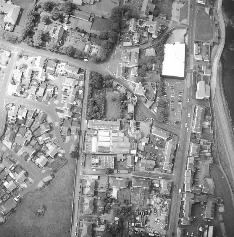 Oblique aerial view centred on the house and stables, taken from the NE.