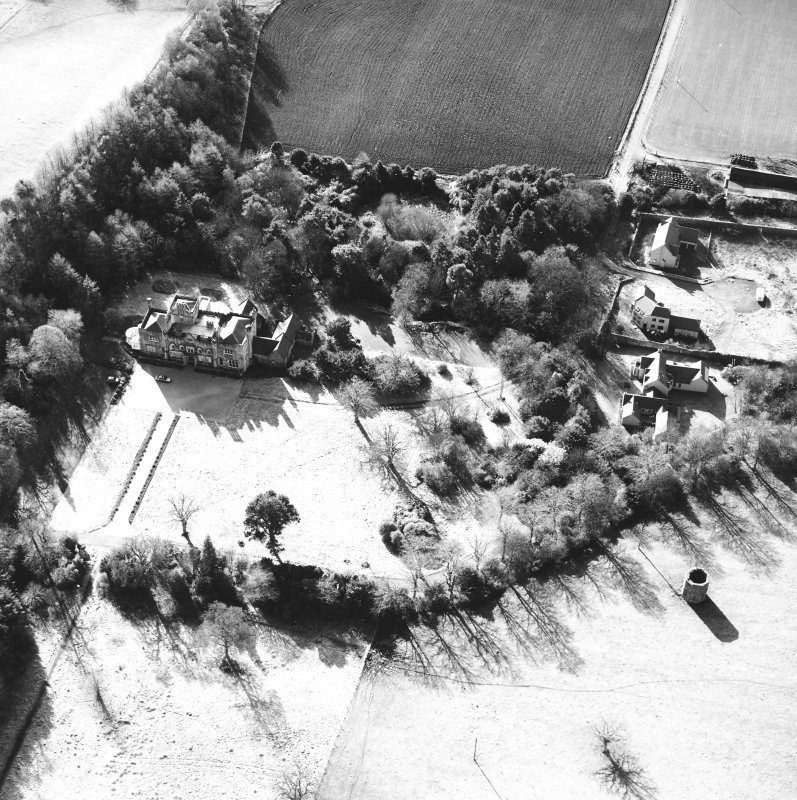 Oblique aerial view taken from the NE, centred on the country house. A dovecot is visible in the bottom right-hand corner of the photograph.