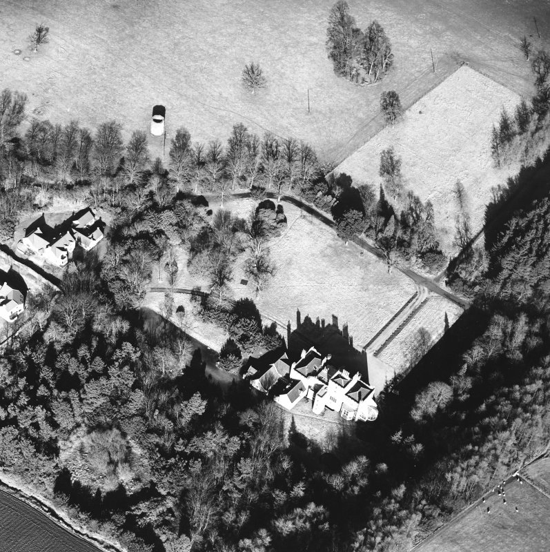 Oblique aerial view, taken from the SW, centred on the country house. A dovecot is visible in the top right-hand corner of the photograph.