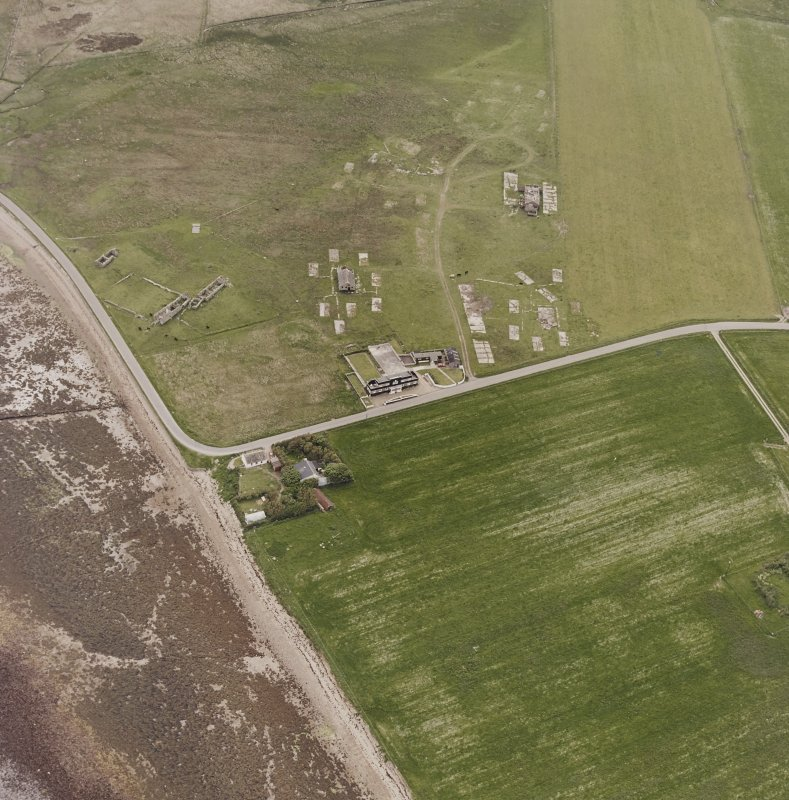 Hoy, Doonatown, oblique aerial view, taken from the ENE, centred on The Garrison Theatre, Lyness Military Headquarters and Camp, and a ruined farmstead.