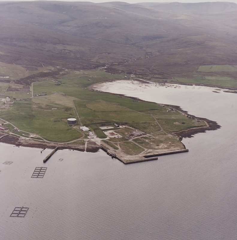 Hoy, Lyness, oblique aerial view, taken from the ESE, centred on the Royal Navy Oil Terminal. Visible in the centre left of the photograph is the Naval Cemetery.
