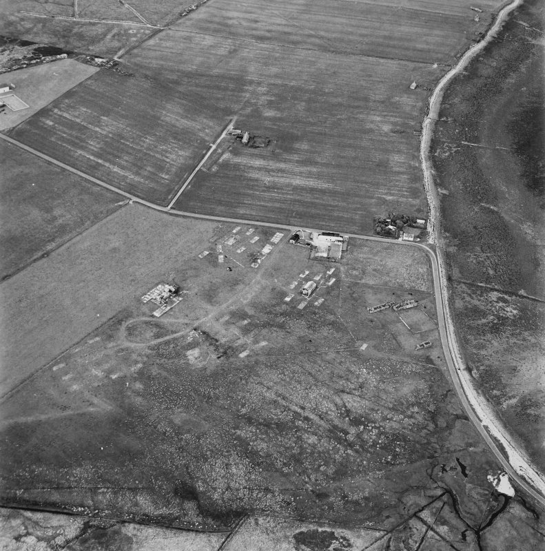 Hoy, Doonatown, oblique aerial view, taken from the SW, centred on The Garrison Theatre, Lyness Military Headquarters and Camp, and a ruined farmstead.