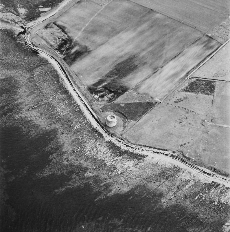 Hoy, Crockness, oblique aerial view, taken from the NE, centred on the Martello Tower and a curving linear soilmark.