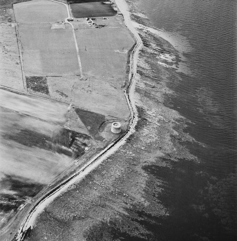 Hoy, Crockness, oblique aerial view, taken from the SE, centred on the Martello Tower. A curving linear soilmark is visible in the bottom left hand corner of the photograph.