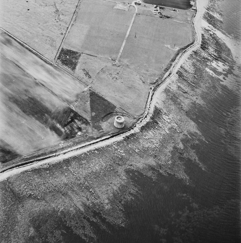 Hoy, Crockness, oblique aerial view, taken from the ESE, centred on the Martello Tower. A curving linear soilmark is visible in the centre left of the photograph.