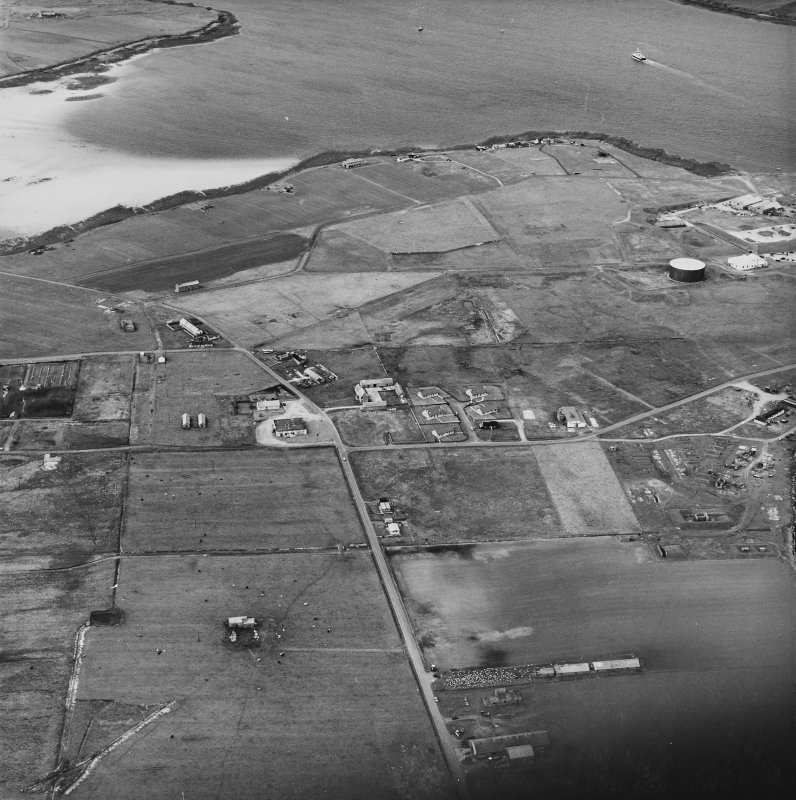 Hoy, Lyness, oblique aerial view, taken from the SSW, centred on the Royal Navy Oil Terminal, and showing the Naval Cemetery in the centre left of the photograph.