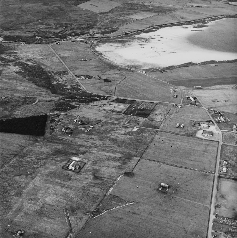 Hoy, Lyness, oblique aerial view, taken from the S, centred on the Naval Cemetery and a pumping station, and showing the edge of the Royal Naval Oil Terminal in the right half of the photograph.
